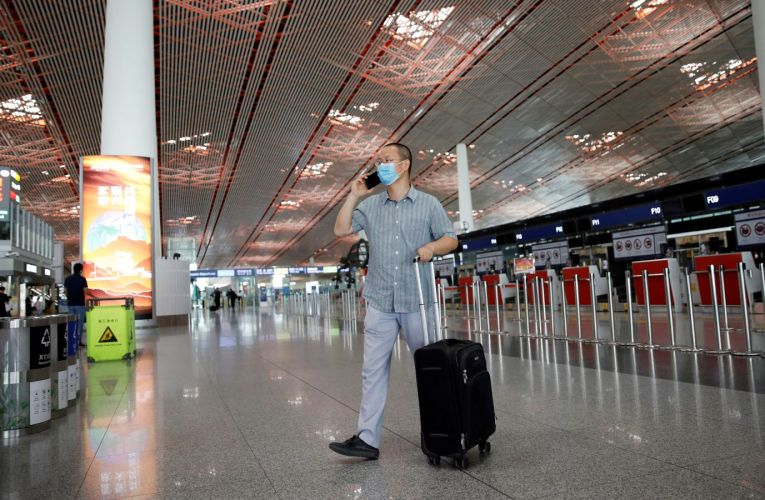 Coronavirus: New travel bans in Beijing as COVID-19 infections spread | World News