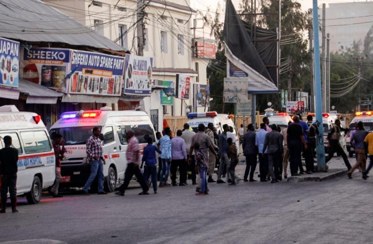 Ongoing siege following automotive explosion at resort gate in Somalia's capital