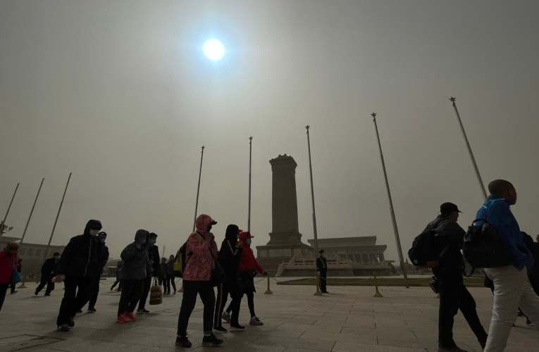 Sandstorm makes sun appear blue and sky yellow in Beijing
