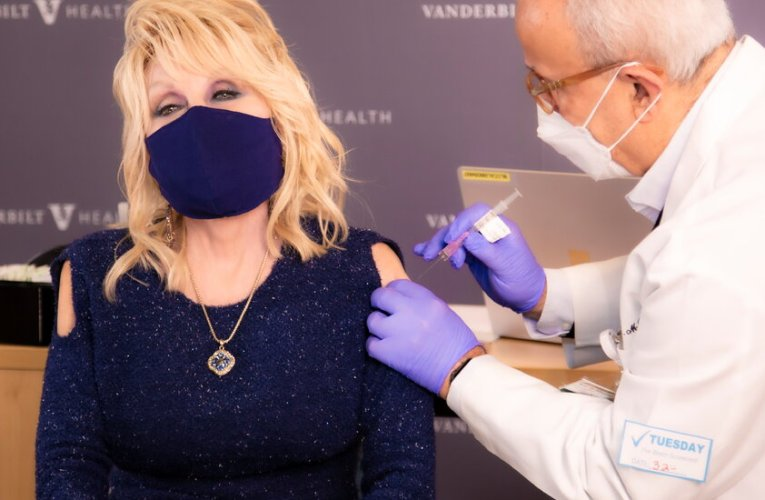 The go-to vaccine outfit? Dolly Parton set the style with a cold-shoulder top.