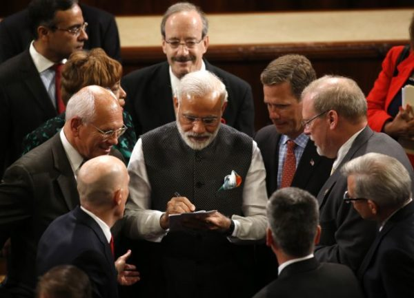 India Prime Minister Narendra Modi signs autographs after addressing a joint meeting of Congress in the House Chamber on Capitol Hill in Washington