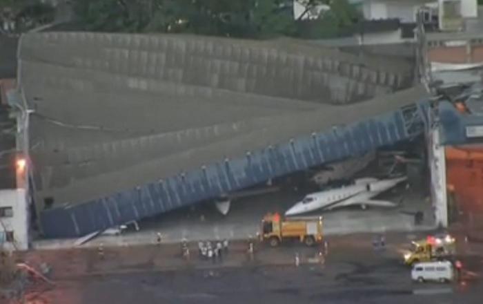 Perspectiva frontal do hangar, numa imagem recolhida do lado da pista de aterragem