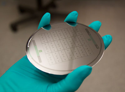 """Wafers like the one shown here are used to create """"organ-on-a-chip"""" devices to model human tissue. (Photo by Anurag Mathur, Healy Lab)"""