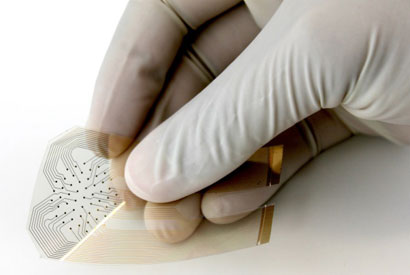 The smart bandage is fabricated by printing gold electrodes onto a thin piece of plastic. This flexible sensor uses impedance spectroscopy to detect bedsores that are invisible to the naked eye. (Image courtesy of UC Berkeley)