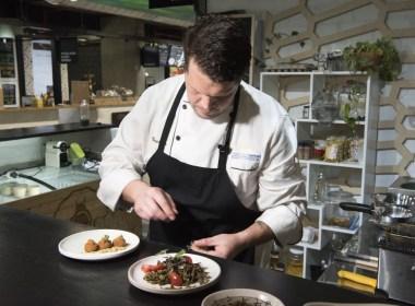 Mario Barnard, chef at Gourmet Grubb, works at his food stand
