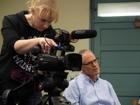 Emilie Johnson monitors the camera shot while instructor Jeff Browne conducts an interview in the Armory on CU's main campus on Friday, January 23, 2015. (Photo/Roxann Elliott)