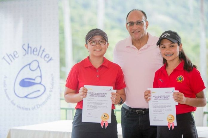 Scott Hamilton, centre, Chairman of The Shelter for Battered Women and Children, with Caylynn Hosein, right, and Ye Ji Lee, winners of The Shelter's annual golf charity tournament.