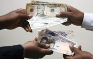 Naira drops to 390 per dollar
