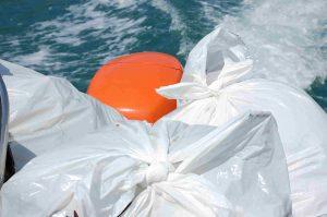 Doldrum Beach Clean Rib full of bags