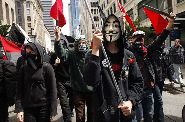 anonymous protesters marching