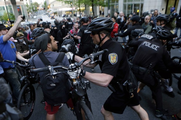 police use bicycle as weapon