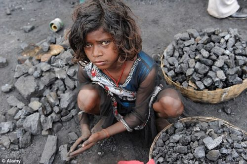 Child worker collecting coal