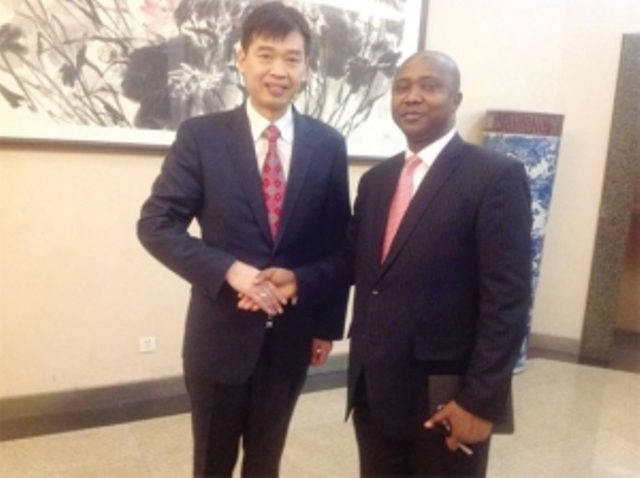 Mr Odame (right) and Mr Zhang Li in a pose after the press briefing.