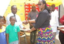 THE EXECUTIVE DIRECTOR OF MTN GHANA FOUNDATION MRS CYNTHIA LUMOR PRESENTING THE BOOKS OF THE MONTH TO BENEFICIARY READING CLUBS FOR SEASON TWO OF MTN JOY FM READING CLUB SEASON TWO (1)
