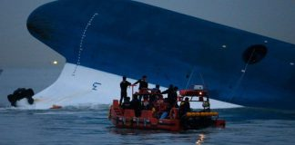 """Maritime police search for missing passengers near capsized South Korean ferry """"Sewol"""" at the sea off Jindo"""