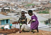 Kenyan children play at the sprawling Mathare slum, one of the largest and poorest in Africa. Photograph: Antony Njuguna/Reuters
