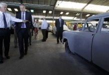 The Chamber of Commerce's head, Thomas Donohue (left), visited a private-run garage in Cuba ?