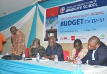 The picture 100 shows dignitaries at the seminar