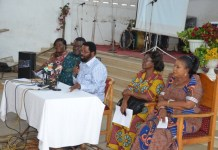 Dr Vanderpuije addressing the meeting with Mrs Kumah-Mintah seated right