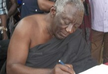 Ex-Prez Kufuor signing the book of condolence