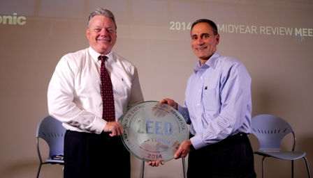 Panasonic Corporation of North America CFO Mike Riccio (photo right), who led the company's effort to secure LEED certification, presents the LEED Platinum plaque to company Chairman & CEO Joseph M. Taylor (left).