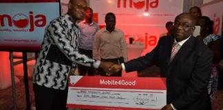 Mobile technology to transform 'blood donation' in Ghana_Ernest Gavor receiving a cheque at the Mobile 4 Good event
