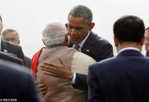 Embrace: President Barack Obama hugs India?s Prime Minister Narendra Modi as he arrives at Air Force Station Palam in New Delhi ahead of a three-day state visit