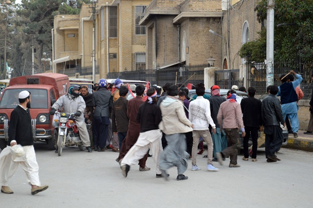 Pakistani Christians stop traffic during a protest against suicide bomb attacks on churches in Lahore in southwest Pakistan's Quetta on March 15, 2015. At least 14 people were killed and 78 others wounded when two suicide bombers blew themselves up at the entrance of churches in Pakistan's east city of Lahore on Sunday, hospital sources said. (Xinhua/Irfan)