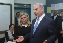 Israeli Prime Minister Benjamin Netanyahu (front) receives interview after casting his ballot at a polling station during the parliamentary election in Jerusalem, on March 17, 2015. Israel held parliamentary election on Tuesday. (Xinhua/JINI/POOL/Marc Israel Sallem)