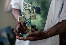 Robert Green, a Lower Ninth Ward resident and Hurricane Katrina survivor, shows a faded photo of her grand daughter, who was killed in the hurricane at the age of 3, in Lower Ninth Ward, New Orleans, Louisiana, June 12, 2015. Ten years after Hurricane Katrina brought New Orleans to its knees and left an emotional footprint across the United States as people witnessed how the U.S. government failed to respond promptly, a predominantly African-American community of the city still struggles to define what their post-Katrina life would be. (Xinhua/Li Muzi) (lrz)