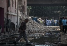 People gather at the explosion site in front of Italian consulate in downtown Cairo, Egypt, July 11, 2015. A powerful explosion occurred in front of Italian consulate in downtown Cairo Saturday, killing one person and injuring four, state-run news agency MENA reported. (Xinhua/Pan Chaoyue) (cl)