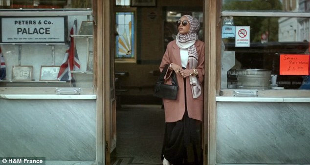 Mariah Idrissi, 23, who is of Pakistani and Moroccan heritage and based in London, appears for a brief moment in H&M's video wearing a checkered hijab and sunglasses (pictured)