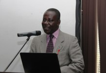 Mr, Seth Osei Akoto Deputy Director of crop service, MOFA addressing the meeting on behalf of the sector Minister