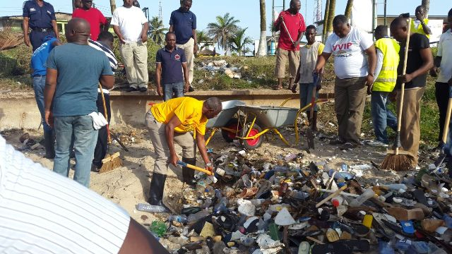 Alhaji Collins Dauda, Local Government and Rural Development Minister, the Central Regional Minister, Thomas Aquinas Quansah and Municipal Chief Executive, Mr I. K. Sam in action and Nana Kodwo Condua VI cleaning along the sea.