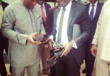 Tonyi Senaye with President Mahama during the official opening of the Accra outlet of Horseman Shoes