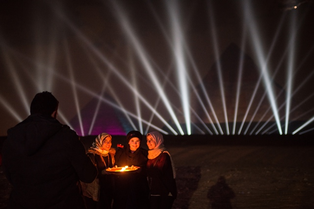 People pose for photos during New Year celebrations at the pyramids in Giza, Egypt, on Jan. 1, 2016. (Xinhua/Pan Chaoyue)