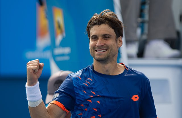 David Ferrer of Spain celebrates victory after the third round match of men's singles against Steve Johnson of the United States at the Australian Open Tennis Championships at Melbourne Park in Melbourne, Australia, Jan. 23, 2016. Ferrer won 3-0. (Xinhua/Bai Xue)