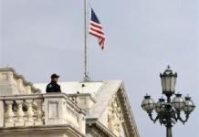 The U.S. flag is seen at half-staff on Capitol Building in honor of the victims of the Brussels attacks, in Washington, D.C. March 23, 2016. (Xinhua/Yin Bogu)