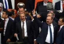 AFP / Adem Altan Ruling party legislators in Ankara on May 20, 2016, vote on a controversial bill to strip dozens of pro-Kurdish and other lawmakers of their parliamentary immunity