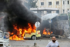 Sana/AFP A car in flames at the scene of bombings in the Syrian city of Tartus, northwest of Damascus, on May 23, 2016