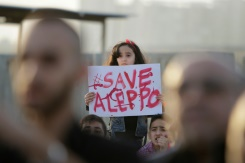 AFP / Ibrahim Chalhoub A Syrian girl holds a placard during a rally in solidarity with Aleppo, in the Lebanese northern port city of Tripoli, on May 1, 2016