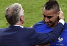 Dimitri Payet being mobbed by coach Didier Deschamps