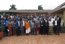 Ms Tove Degnbol in a group photo with dignitaries and participants
