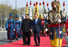 South Korean President Moon Jae-in (R) meets with top leader of the Democratic People's Republic of Korea (DPRK) Kim Jong Un in the border village of Panmunjom on April 27, 2018. Moon Jae-in arrived Friday morning in the border village of Panmunjom for his first summit with Kim Jong Un. (Xinhua/Inter-Korean Summit Press Corps)