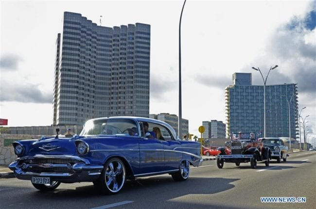 Photo taken on Jan. 5, 2019 shows vintage cars running in the streets in Havana, capital of Cuba. More than 200 vintage cars took to the streets of Havana Saturday for a contest. (Xinhua/Joaquin Hernandez)