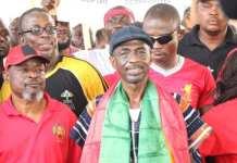 General Secretary of the NDC, Asiedu Nketia [with the Ghana flag around his neck]