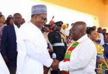 President Akufo-Addo exchanging pleasantries with Muhammadu Buhari, President of Nigeria.