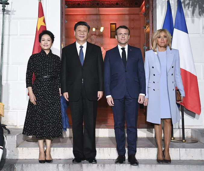 Chinese President Xi Jinping (2nd L) and his wife Peng Liyuan (1st L) pose for a group photo with French President Emmanuel Macron (2nd R) and his wife Brigitte Macron in the southern French city of Nice on March 24, 2019. Xi met with Macron in Nice on Sunday. (Xinhua/Xie Huanchi)