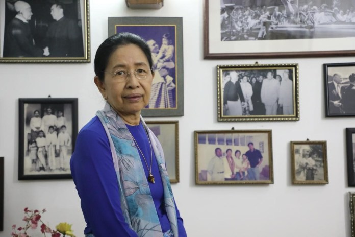 Secretary of the Democratic Party of Myanmar Mya Than Than Nu tells her story with China in front of photos recording the precious moments of China-Myanmar friendship. (Photo by Zhao Yipu, People's Daily)