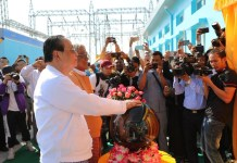 Myanmar's Union Minister for Electricity and Energy U Win Khaing inaugurates the 230KV Nabar-Shwebo-Ohntaw Power Transmission Line and Substation Project undertaken by the State Grid Corporation of China at the completion ceremony of the project. Photo by Sun Guangyong, People's Daily